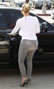 Kim Kardashian downblouse and shows booty while out for shopping in West Hollywo