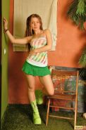 Cute teen dressed in sexy short skirt and green boots showing tits and ass