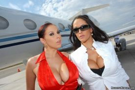 Mile high club threesome with big titty porn stars