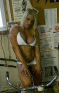 Lovely blonde with muscle body shows her big clit outdoors
