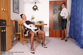 Maid worshiping legs in stockings