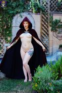 Magical pale redhead naked Cosplay in the garden