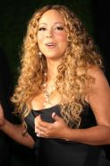 Mariah Carey busty wearing a low cut black dress at the  2012 HALO Awards in Hol