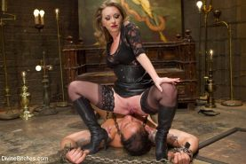 Mistress T canes a well endowed all muscle slave into submission