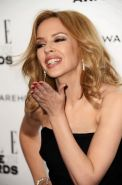 Kylie Minogue busty and leggy wearing black tube mini dress at ELLE Style Awards