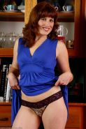 Hairy mature redhead milf bares her hairy red bush