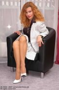 Redhead Lady Claire in nylon Stockings