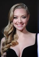 Amanda Seyfried shows off her sexy chest wearing low cut black dress at Les Mise