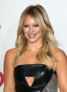 Hilary Duff braless shows underboobs in a tiny leather mini dress at 2014 Iheart