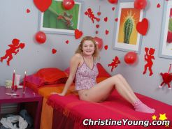 Pretty teen girl Christine Young posing with a lollypop