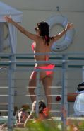Eva Longoria flaunts her fabulous body in a hot pink bikini poolside in Miami