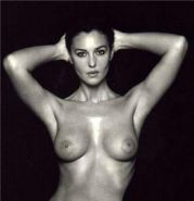 Cute italian actress Monica Bellucci showing perky tits