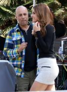 Maria Menounos shows off her legs and ass wearing a tight mini skirt on the set