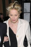 Sharon Stone showing her sexy and hot legs in black skirt