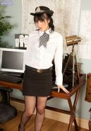Vikki Gabrielle sexy cop in stockings strips at office