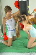 Lesbian teen coeds playing with each others pussies