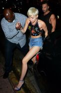 Miley Cyrus in denim shorts and belly top at Cameo Nightclub in Miami