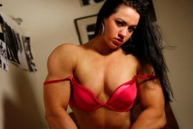 Gorgeous young muscle girl shows off her sexy muscles