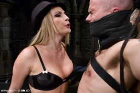 Mistress Harmony with two bound slaves forced to please here