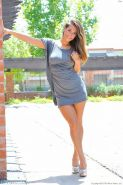 Cute girl flashes her gorgeous body in public park