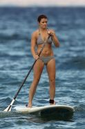 Danica Patrick showing cameltoe in bikini while paddle surfing in Hawaii