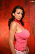 Jana Defi takes off her pink top and shows us her massive melons