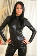 Babe In Black Leather Catsuit