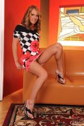 Zuzana Z blonde on high heels strips and spreading
