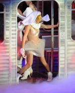 Lady Gaga in see through outfit with taped nipples performing at the 02 Arena in