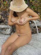 Naked lactating busty babe spreading her hairy pussy