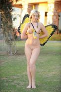 Curvacious blonde in her nude butterfly costume