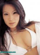 Lucy Liu showing her nice tits and posing very sexy on bed