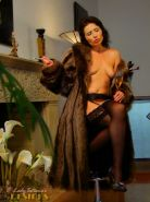 Lady Tatiana with her kinky dildo chair dressed in sexy nylons