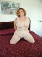 Naked horny bbw in bed loves rubbing her shaved pink pussy