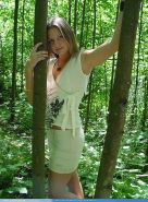 Pictures of Josie Model showing her tits in the woods
