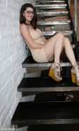 Brunette coed Amber Hahn shows you what's under her dress on the stairs