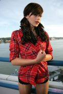 Pretty girl Autumn Riley strips out of her flannel shirt on the balcony