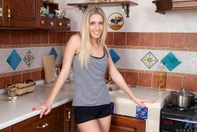 18 year-old college girl Marsa rubs her throbbing clit in the kitchen