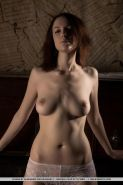 Erotic model Lavana strips naked in front of a piano