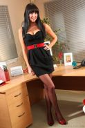 Dark haired stunner loves to flirt in her office by slipping out of her tight black dress.