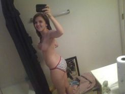Pictures of a busty amateur teen girlfriend taking pics of herself
