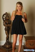 Pictures of teen Kelly Brooke stripping out of her black dress