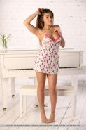 "Brunette girl Foxy Salt is ready for her piano lessons in ""Rinola"""
