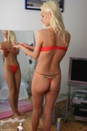 Pictures of Allizee teasing in red underwear at home