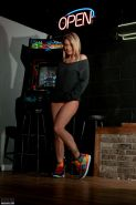 Nikki gives you a sexy nerdy striptease with an arcade machine