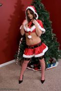Pictures of Nikki Sims wrapping herself up for you for xmas