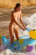 Pictures of Kristina Fey having some naked fun on the beach