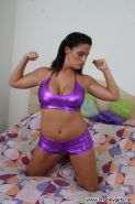 Hot curvy girl Whitney strips out of her shiny purple outfit and spreads her pussy