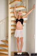 Pictures of blonde teen girl Justine having some fun at home