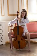 Beautiful girl Milla plays you sweet music with her cello and her pussy